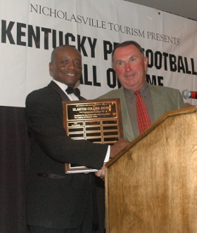 Frank Minnifield presents the 2007 Blanton Collier Award to University of Kentucky Coach Rich Brooks